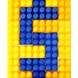 Stock Photo: Dollar sign made from building block of meccano