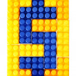 Dollar sign made from building block of meccano — Stock Photo
