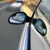 Car driving fast on road — Stock Photo