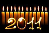 2011 - Twelve alight candles — Stock Photo