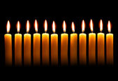 Twelve alight candles — Stock Photo