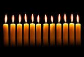 Twelve alight candles — Stock Photo
