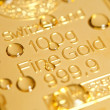 Drops on a gold ingot — Stock Photo