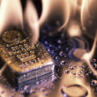 Stock Photo: Goldbars and flame