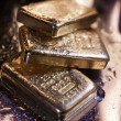 Goldbars  and  flame — Stock Photo