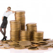 Busines woman with column coins — Stock Photo
