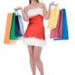 Beauty girl in santa hat with color bag — Stock Photo