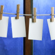 Four photo paper attach to rope with clothes pins — Stock Photo #4989602