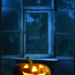 Halloween pumpkin in night on old wood room - Stockfoto