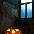 Halloween pumpkin in night on old wood room - Zdjęcie stockowe