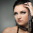 Young naked woman in chain - Stock Photo