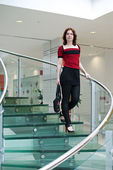 Beauty woman on glass stair — Stock Photo