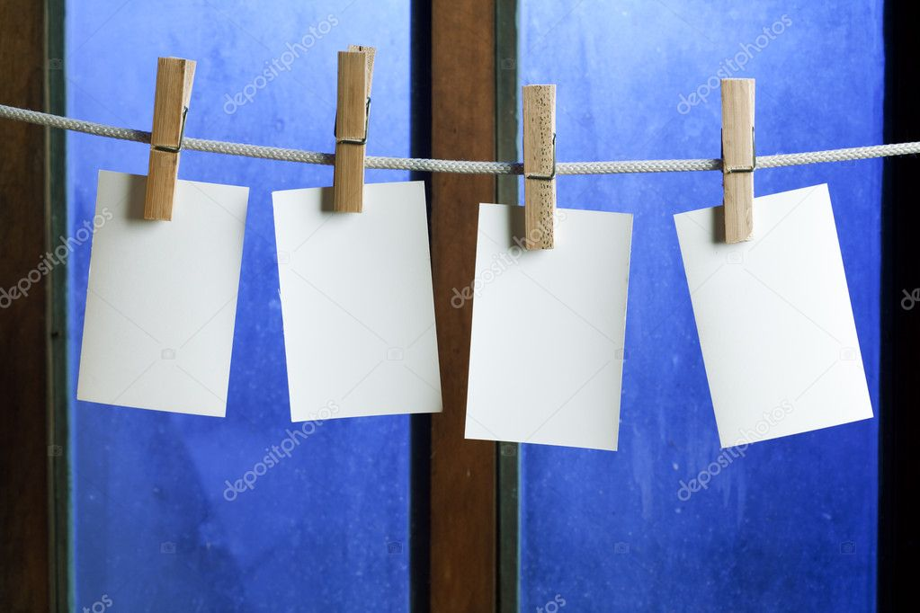 Four photo paper attach to rope with clothes pins on window background — Stock Photo #4989602