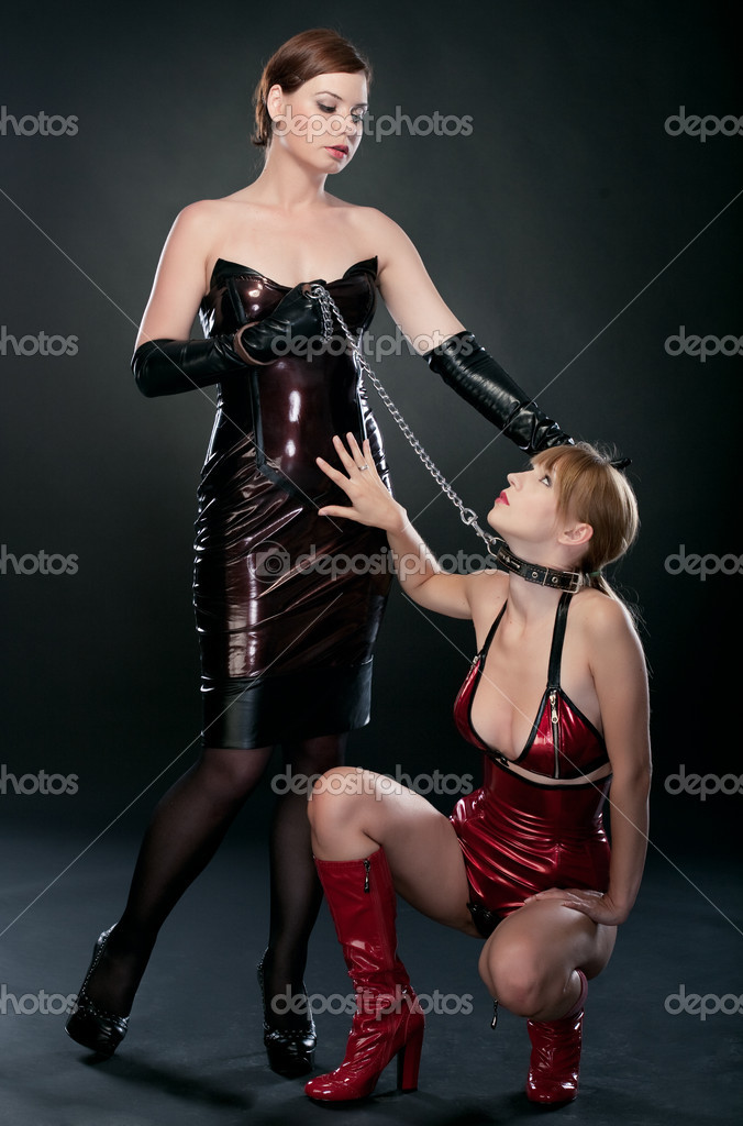 Beauty fetish bdsm woman in dresses on black background  Stock Photo #4989862