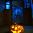 Halloween pumpkin in night on old wood room — Stock Photo