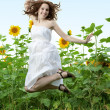 Beauty woman in sunflower — Stock Photo #4990472