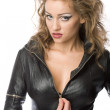 Beauty woman in leather overalls — Stock Photo