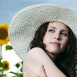 Beauty woman in sunflower — Stock Photo