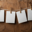 Four photo paper attach to rope with clothes pins — Stock Photo