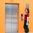 Woman with elevator - Stockfoto