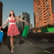 Beauty woman in city — Stock Photo