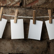 Five photo paper attach to rope with clothes pins — Stock Photo #4990808