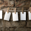 Five photo paper attach to rope with clothes pins - Stock Photo