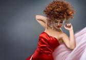 Beauty redheaded girl in fashion dress — Stock Photo