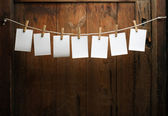 Photo paper attach to rope with clothes pins — Stock Photo