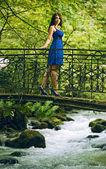 Beauty woman in blue dress — Stock Photo