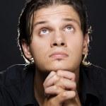 Young man praying — Stock Photo