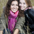 Autumn portrait of two young women — Stock Photo