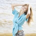 Beautiful young woman at the sea — Stock Photo