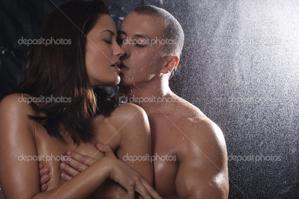 Loving affectionate nude heterosexual couple in shower hugging  — Stock Photo #4059645