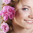 Woman with with braids and roses in hair — Stock Photo