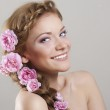 Woman with with braids and roses in hair — Stock Photo #4078707