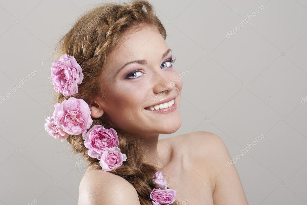 Portrait of young woman with with braids and flowers in hair  Stock Photo #4078707