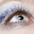 Eye with blue and silver sparkle make-up — Stock Photo #4380592
