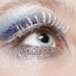 Eye with blue and silver sparkle make-up — Stock Photo #4380603