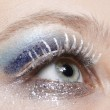 Eye with blue and silver sparkle make-up — Stock Photo #4415831