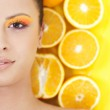 Young beautiful woman with oranges — Stock Photo