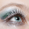 Eye with blue and silver sparkle make-up — Stock Photo #4478772