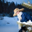 Pretty girl in the winter forest — Stock Photo
