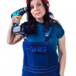 Pretty woman in coveralls with the drill. — Stock Photo