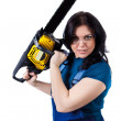 Pretty woman in coveralls with the chainsaw — Stock Photo