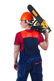 Powerfull worker with the chainsaw — Stock Photo