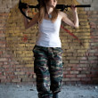 Walking mercenary woman — Stock Photo