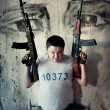 Mercenary with two  'Kalashnikov' submachine guns — Stock Photo