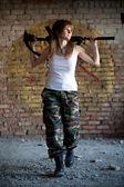 Walking mercenary woman — Stock Photo
