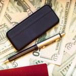 Passport, phone, pen and dollars — Stock Photo